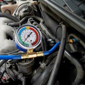 Refrigerant recharger hose low pressure gauge for aircon recharge at Cranmore Garage in Solihull