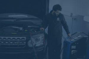 Car aircon regas in progress on range rover